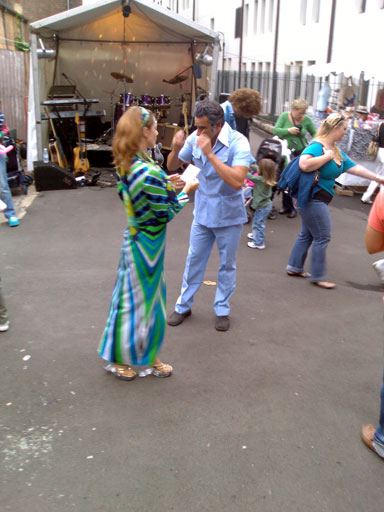 Two dancers in seventies style clothing, part of a Seventies Festival at Susannah Place in The Rocks.