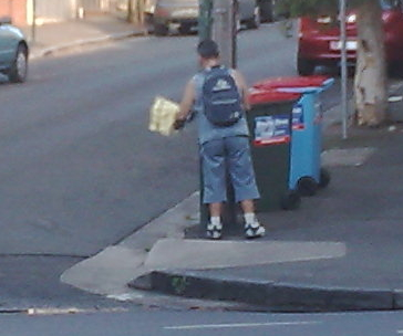 With all this talk of posters on telegraph polls in Sydney at the moment, I thought I'd post this photograph I snapped this morning of a bloke who goes around removing the posters. I don't know if he's paid or just does it because he believes in it, but I saw him do it at three poles this morning, so I thought I'd share.