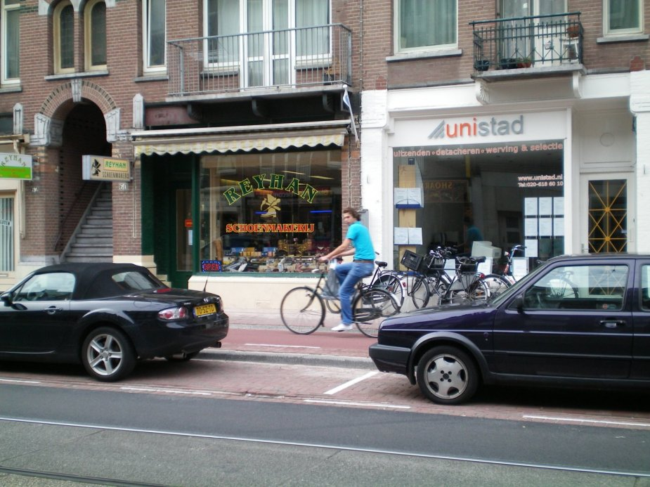 Streets of Amsterdam - cyclists and pedestrians sharing the way...