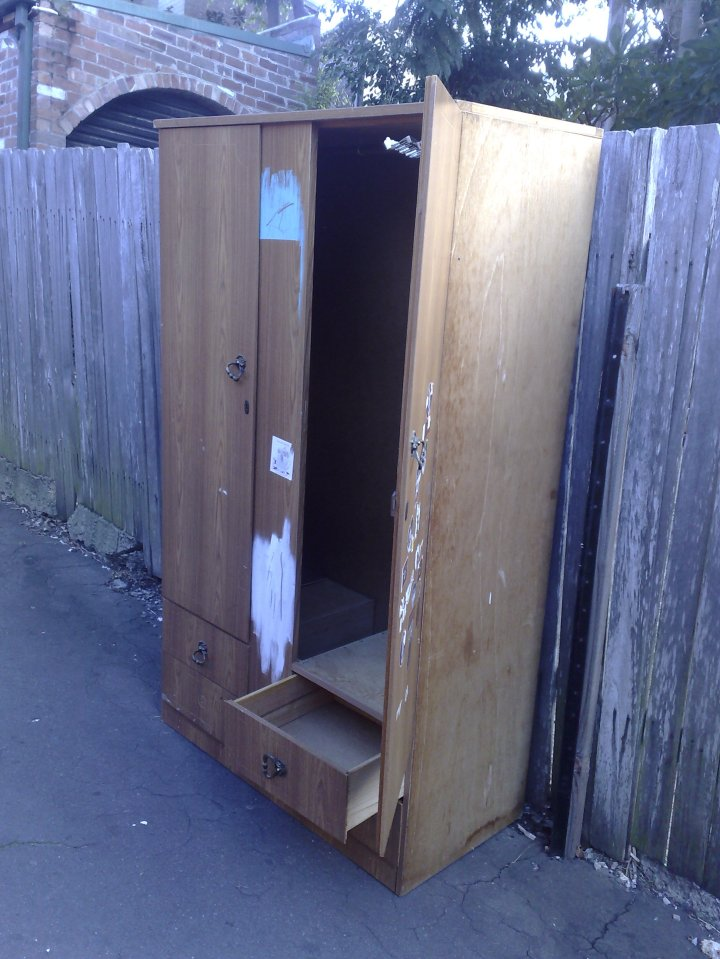 Discarded wardrobe in the back laneway.