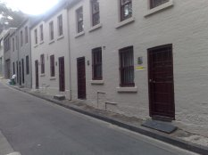 Tilley Devine owned and ran many brothels in this part of East Sydney.