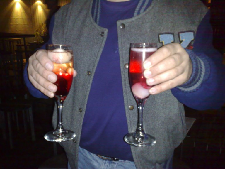 As part of the whole deal, we also had Champagne Cocktails which contained lychees and something which made the drinks red.