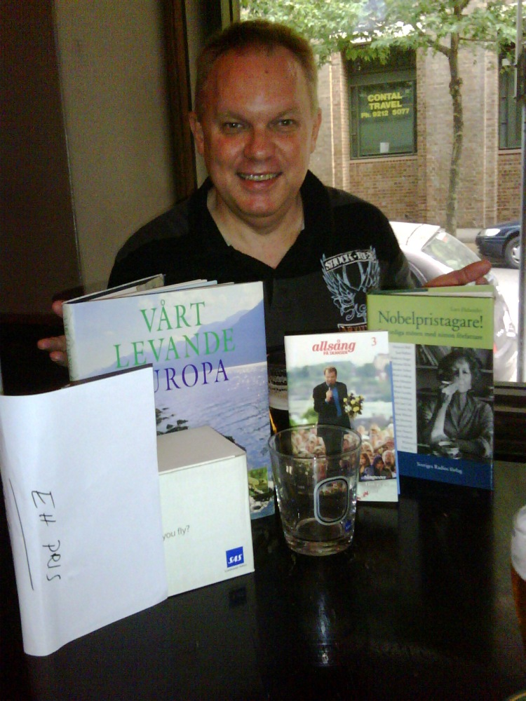 Graeme aka Barbie Rogers shows off the prizes won at the Swedish Bazaar