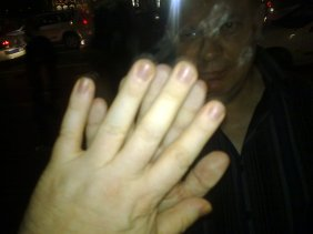Touching hands, separated only by a window, some bouncers and a 2am lockout on Oxford Street.