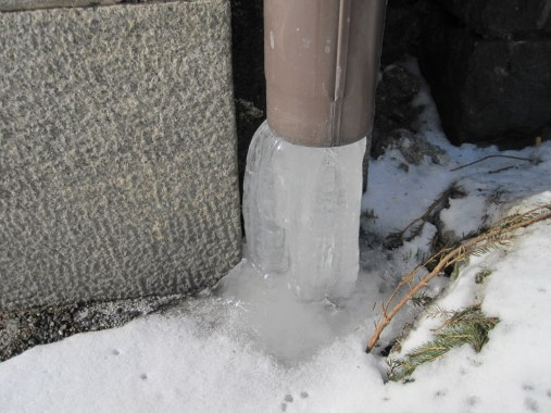 Ice coming out of a drainpipe