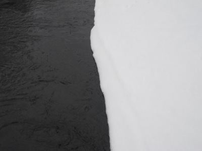 Love the contrast in colour between the river and the snow