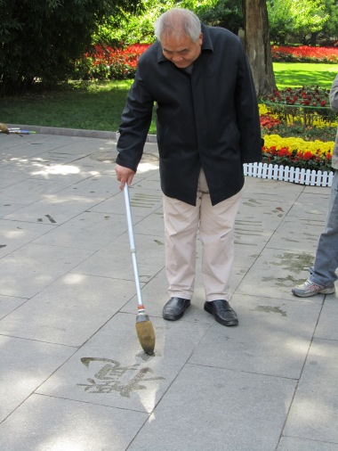 Man practices calligraphy in the park