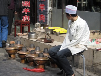 Man selling things in the hutongs
