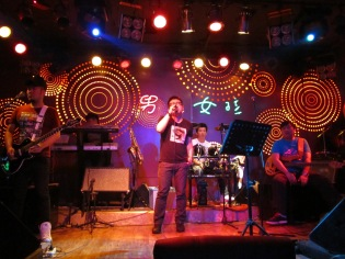 Chinese soft rock band plays in a nearby bar