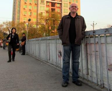 Standing on a bridge