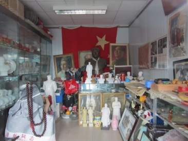 Looking inside a shop window specialising in Mao