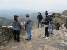 Lots of older people walking and sometime struggling on the Great Wall of China