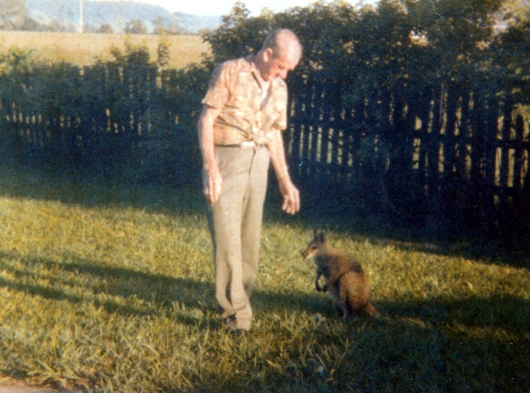 Dad with a Visitor in the backyard, probably about 1980