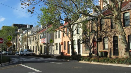 Lots of generations of housing in one row on Bourke Street