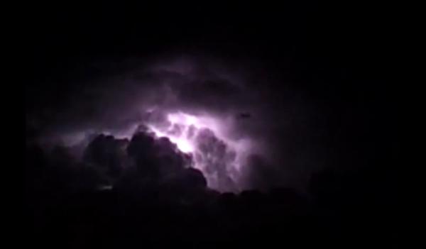 Sitting on the back verandah, watching the lightning.