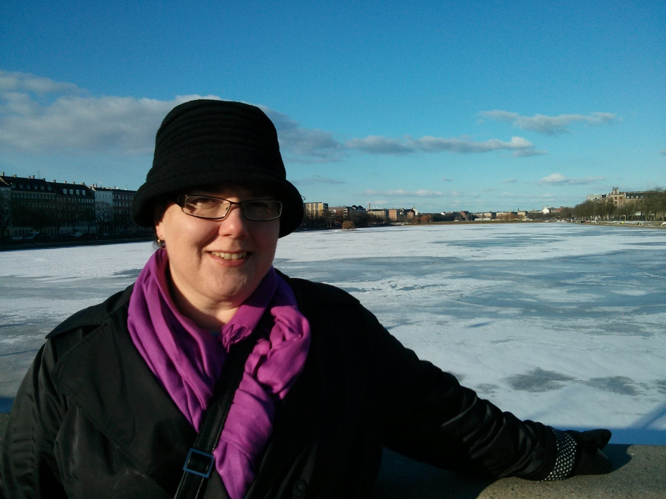 Sue with an ice-covered river background in Copenhagen