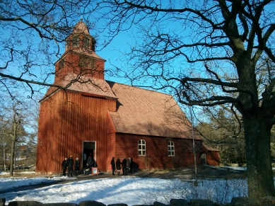 Wedding party goes into church at Skansen