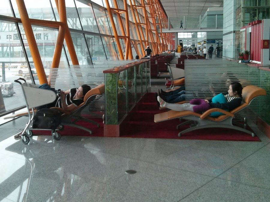 These sleeping chairs at Beijing Airport are awesome.