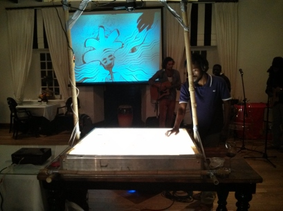Sand art on the big screen at the opening night activity at Radio Days Jo'burg 2013