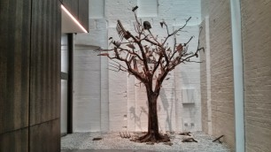 Bai Yiluo's Spring and Autumn 1 (2007), a tree whose branches are old and new farm tools