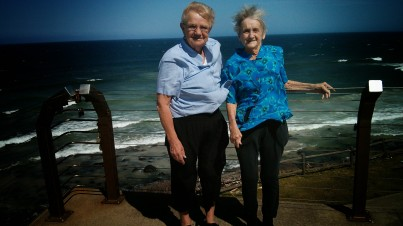 Family getting caught in the strong winds at Ballina, NSW