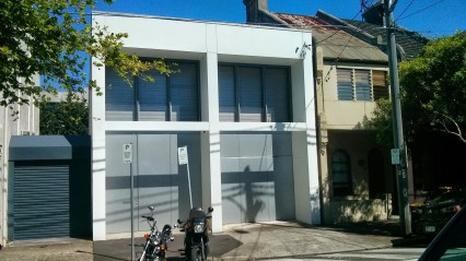 White. Minimalist. Industrial. But in keeping with the lines/styling of a terrace house.