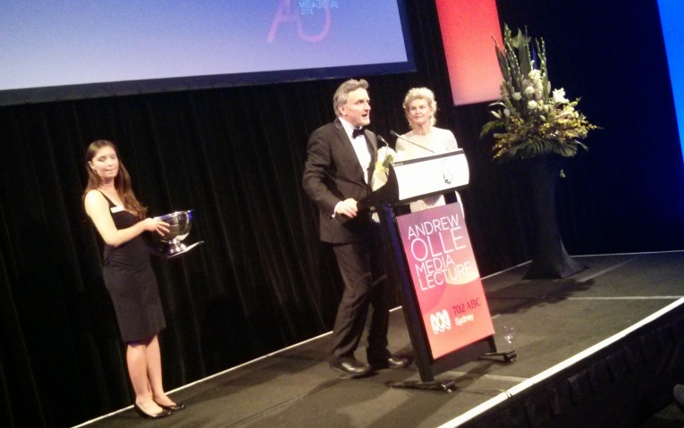 An important part of the evening is the fundraising effort for research into brain cancers. the cause of Andrew Olle's sudden death. Here Richard Glover and Annette Olle draw the winner of a contest. The raffle winner? A team from 702 ABC Sydney who donated it back.