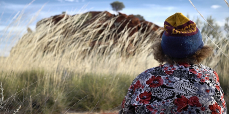 Lizzie Ellis, Still #3, Tjawina Porter at Kuruyurltu, still image from film 'Kuruyurltu', shot by Matthew Woodham. Copyright Tjarlirli Art 2014