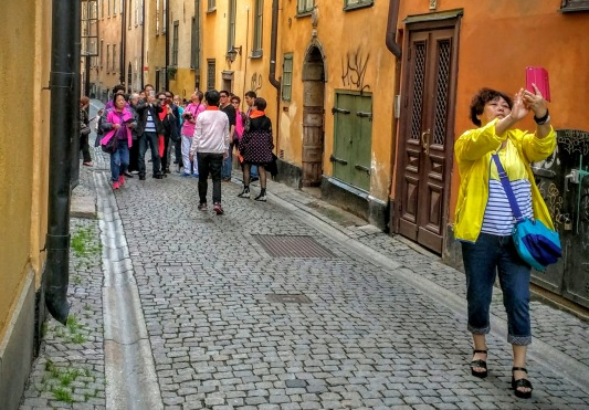 There's so much going on in this photograph on Prästmangatan in Gamla Stan, Stockholm