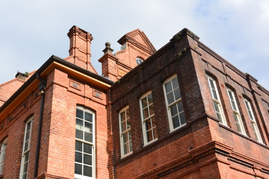 Contrasting the bricks (cleaned and uncleaned) due to the railway pollution at the Sydney Railway Institute