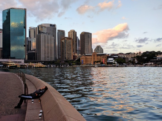Man chats on mobile, early morning, Circular Quay, Sydney