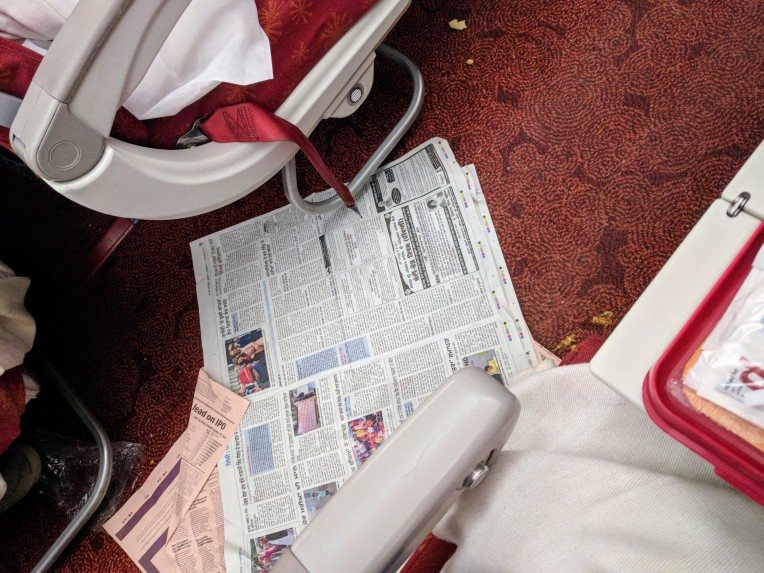 Newspapers on the cabin floor